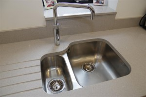 Silesstone® Alumin nube with undermounted sink and Quooker tap.
