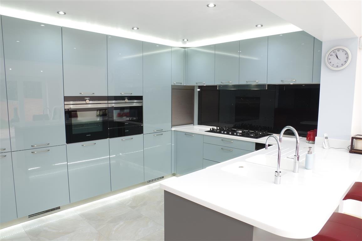 A Contemporary Kitchen with a Banquet Seating Area - PTC Kitchens