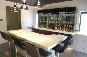 Luxurious bar area with Italian seating by Peressini Casa and Corian Designer White Worktops