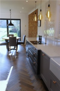Shaker style kitchen in two tones of grey with quartz worktops including cutting a section of wall out to install a critical style glass panel and new amtico flooring throughout all the ground floor