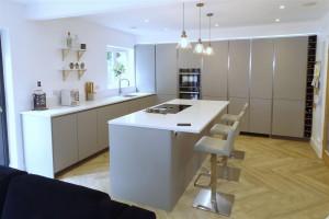 Minimalist Pearl Grey Kitchen with Silestone by Cosentino Miami white worktops with island, Neff appliances, Quooker tap and BORA Basic hob.