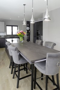 Concrete graphite kitchen with island and breakfast bar connected