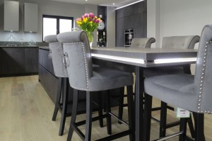 large open plan grey kitchen with island and connected breakfast bar