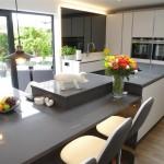 Grey tinted mirror and Y ukon/Marengo worktops with Siemens appliances