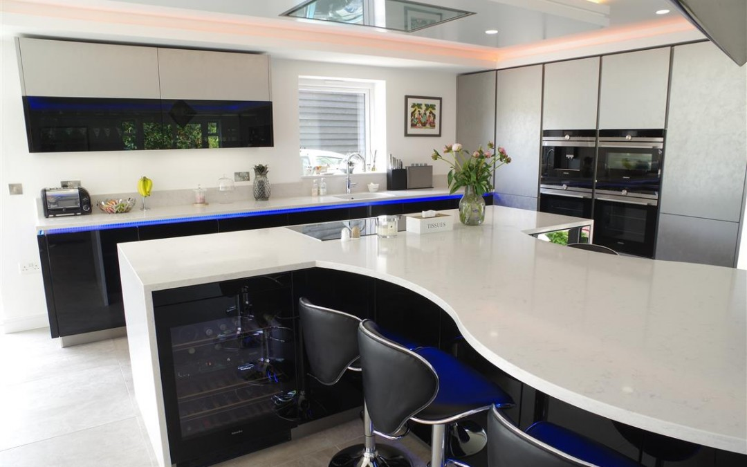 High Gloss Black and White Kitchen with Dramatic Lighting