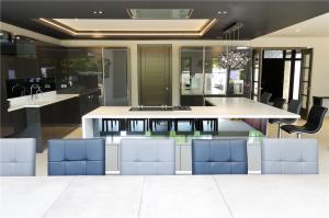 Corian Designer White Worktops with Gutmann Extractor and Gaggenau appliances