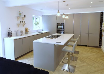 Pearl Grey Kitchen with Miami White island and.. secret doors!