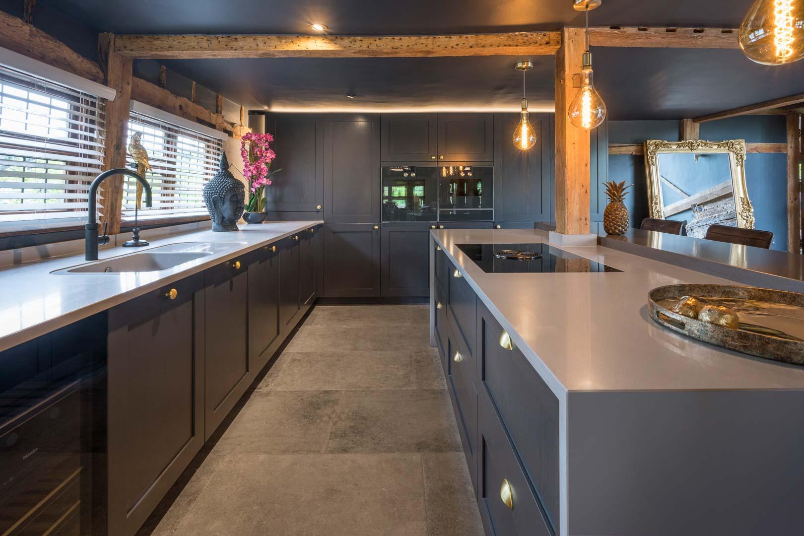 dark grey kitchen with black ceiling